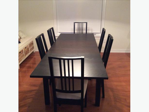 bjurtsa black brown table and six borje chairs with white cushions in