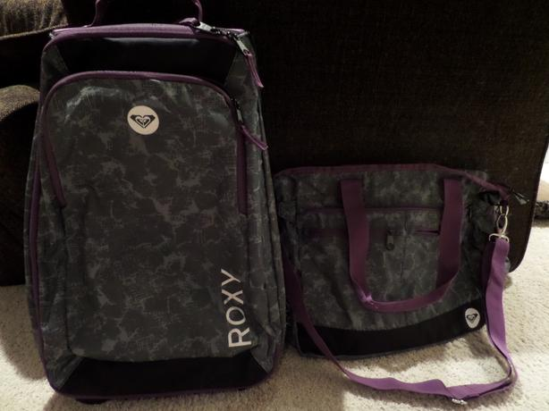 Roxy wheeling carry-on and matching over the shoulder carry-on bag