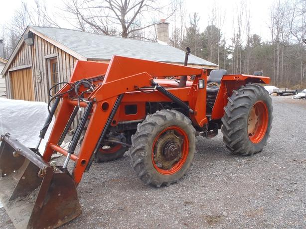 Diesel 4x4 tractor with loader and plow