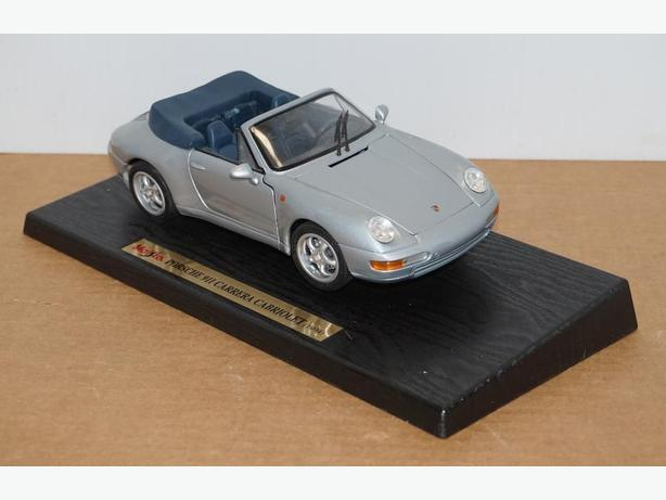 """Porsche 911 Carrera Cabr."" Die-Cast 1:18 Scale Model by Maisto – Good Condition"