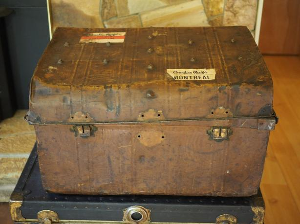 antique metal trunk with stickers