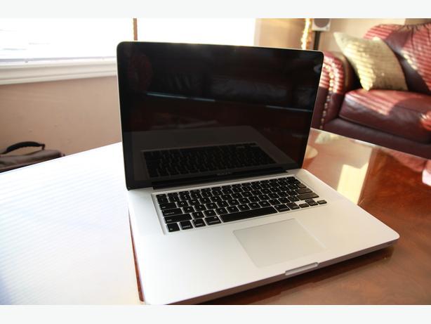 """15"""" MacBook Pro, i5 Processor, 8 Gb Ram, 500 Gb HDD."""