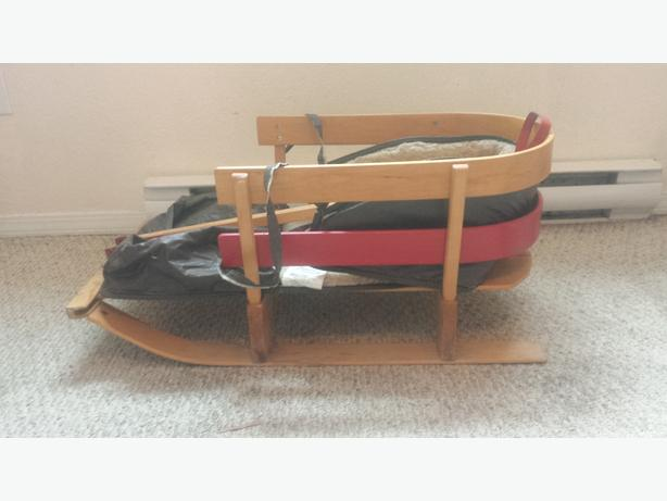 Sled with handle and a seat