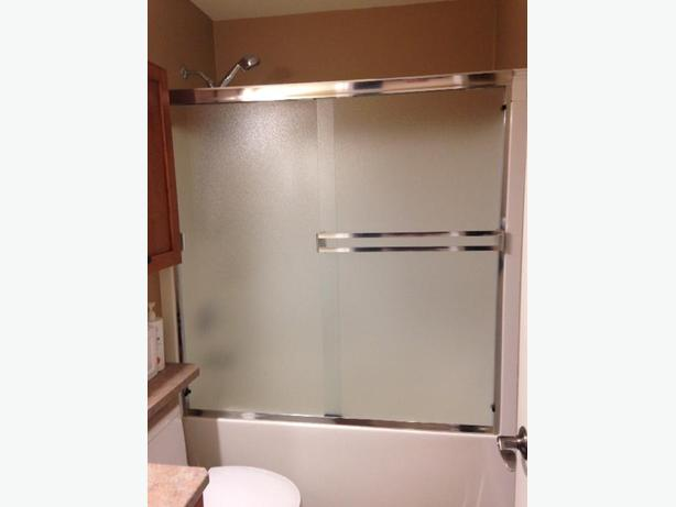 Glass tub enclosure doors