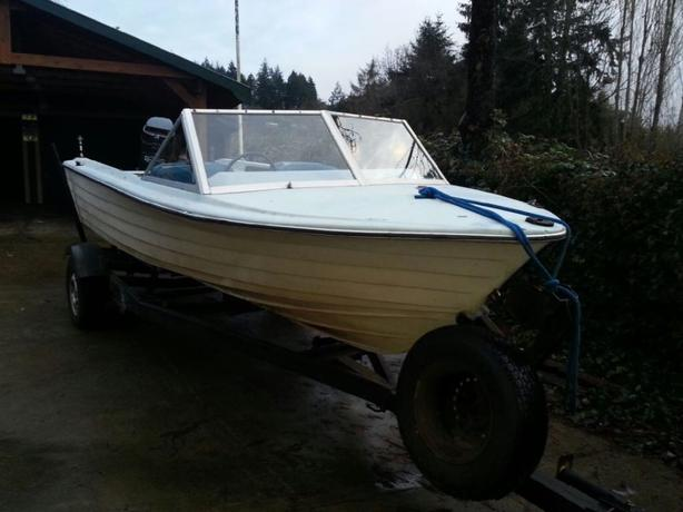 16 Foot glass boat with 115 hp. Mercury and registered trailer