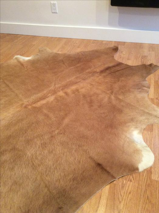 Pretty camel cowhide rug chintz and co soft and like new for Cowhide rug houston