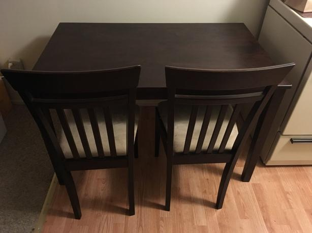 dark brown kitchen table with two chairs in good condition