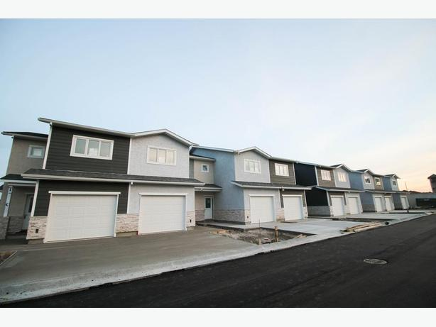 BRAND NEW Beautiful Townhomes In Devonshire Village!
