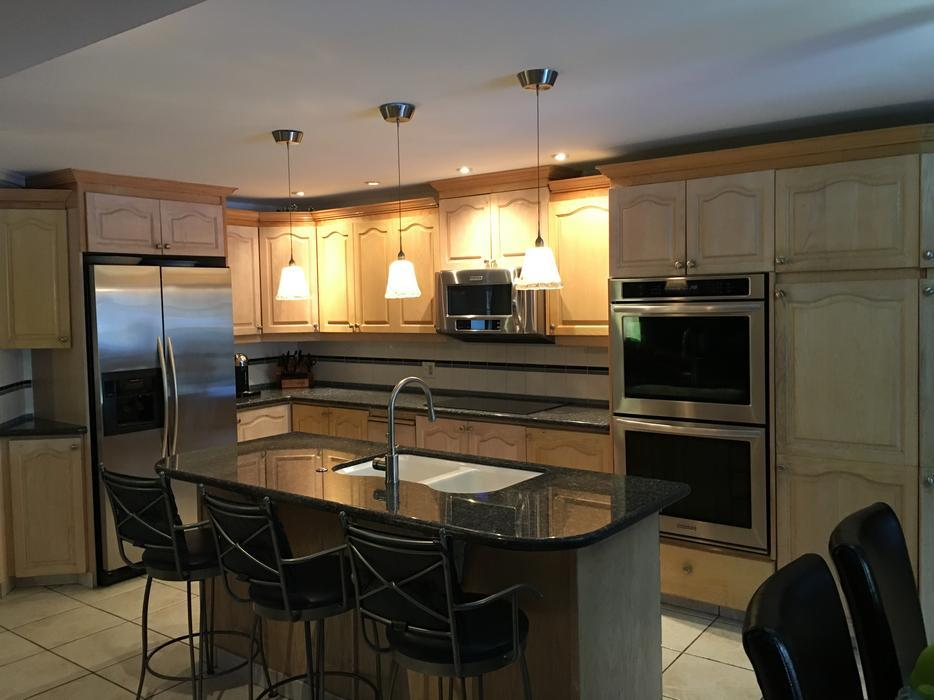 Used kitchen cupboards blue pearl granite top island and for Kitchen cabinets ottawa
