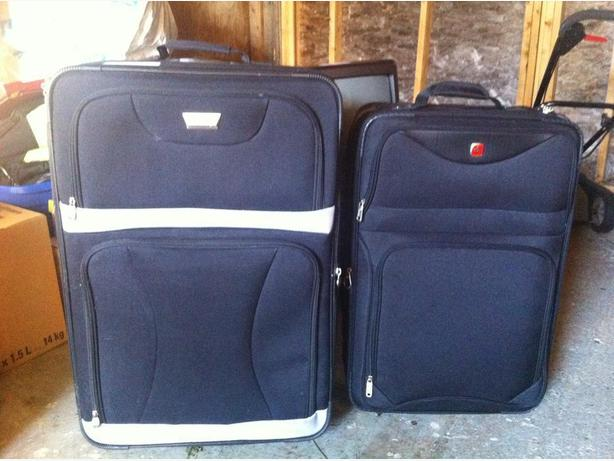 Two large black suitcases