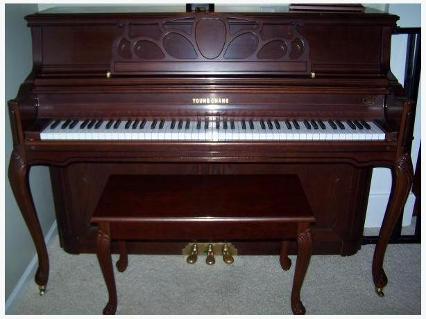 Young Chang gold series upright piano with bench