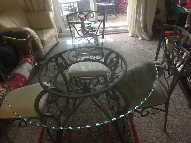 Glass table with four chairs.....