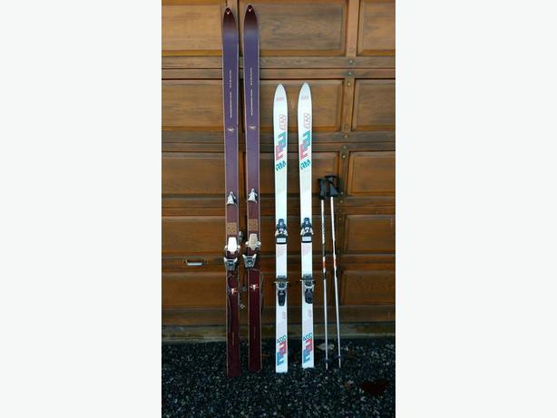 2 Pairs of skis, 1 pr. down hill & 1 cross countrys and 2-poles