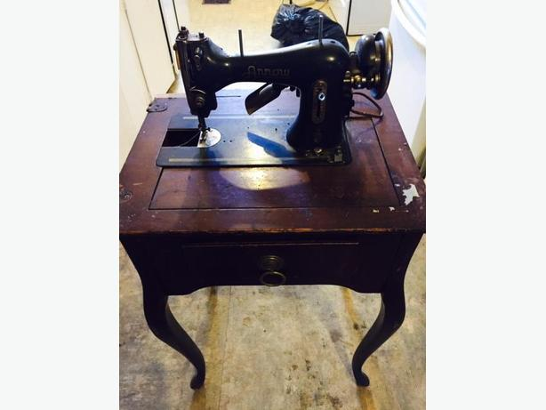 Antique Arrow Sewing Machine On Table Central Regina Regina Interesting Arrow Sewing Machine