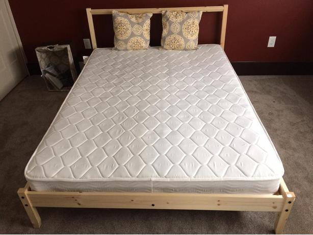 Free (practically new) Ikea Fjellse full-size bed with two matresses