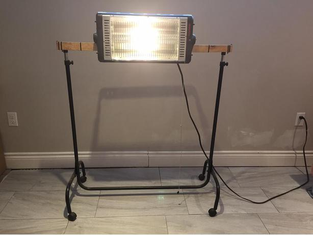 Light and heater on stand for garage