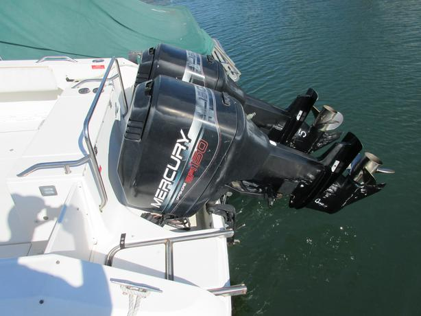 Twin Mercury 150 EFI with mirage stainless props