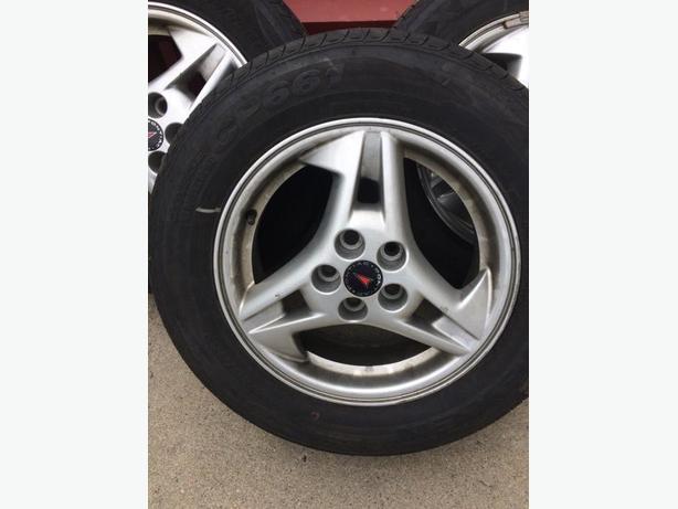 15 inch pontiac sunfire tires n rim x 4