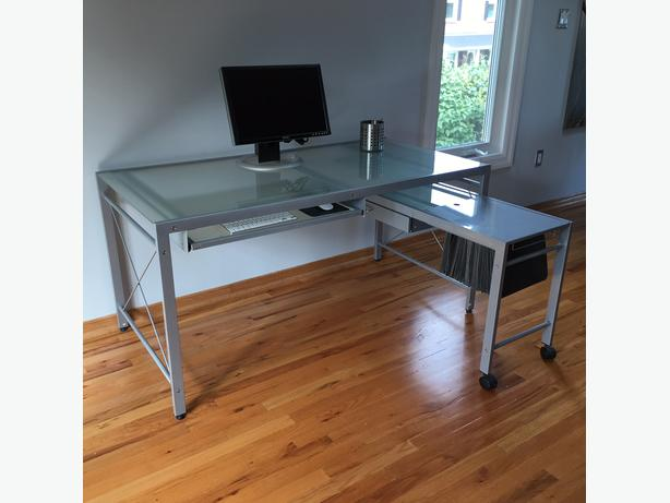 Glass desk with roll away extention