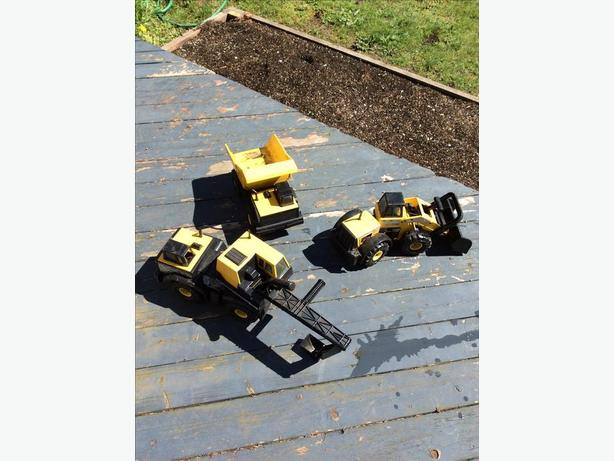Set of three tonka construction trucks