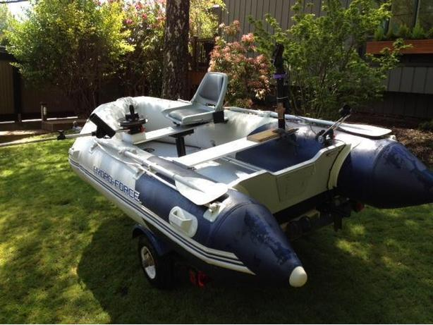 Inflatable boat (almost new) with trailer & fishing toys