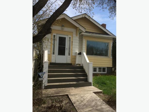 Beautiful 2 bd charcater home with garage across the street from park