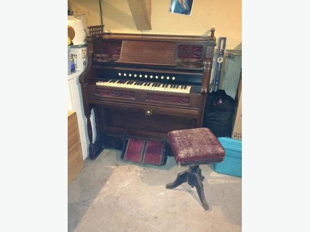 Antique pump organ and stool