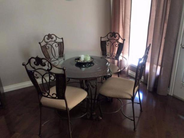 Stunning wooden and glass dining table and 4 chairs