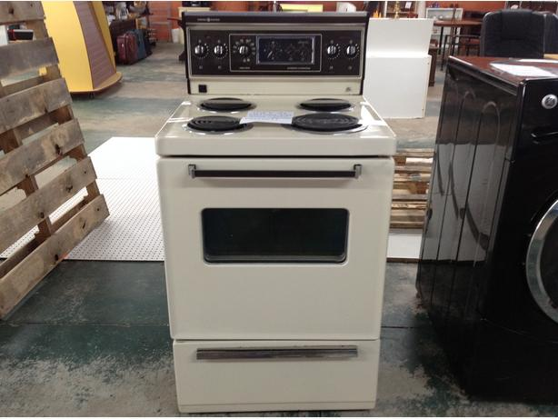 "Used 24"" Apartment size stove..beige and in great shape."