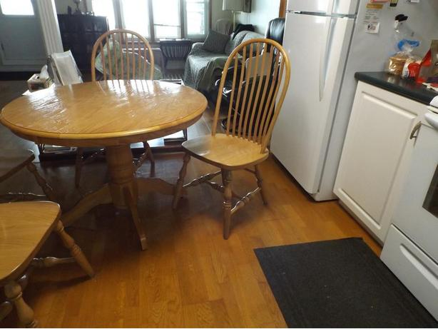 Solid Oak round table and 4 matching chairs