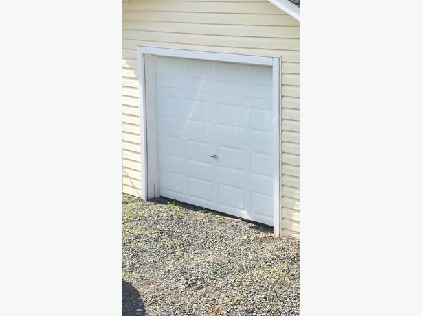 "White 9""x6'9"" white metal garage door"