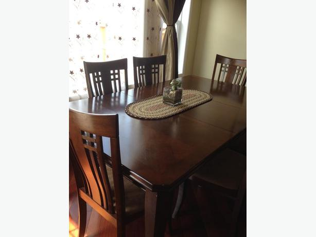 Solid wood 6 feet long dining table with 6 chairs