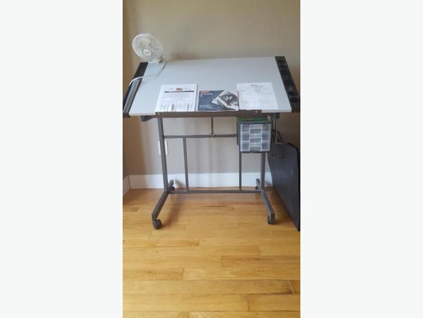 Art drawing table with three drawers.