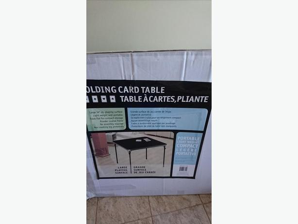 Black Folding Table and a Chair