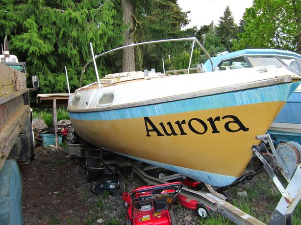 "A solid 3000 lbs trailer with ""Aurora"" 22 trailerable sail boat,"
