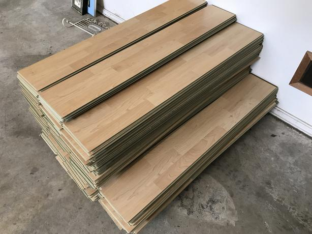 approximately 700 sf of laminate flooring