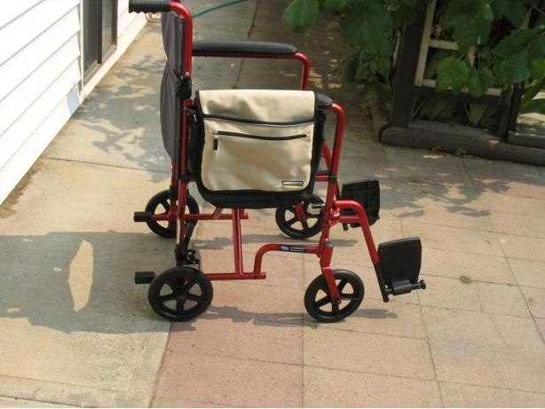 "RED INVACARE ""LIGHT-WEIGHT"" TRANSPORT WHEELCHAIR FOR SALE"