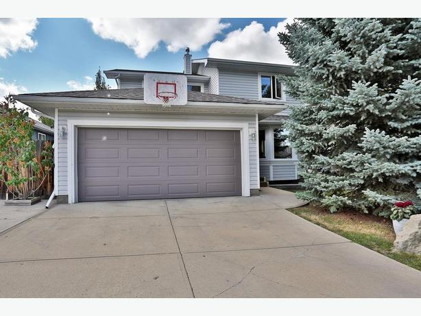 Gorgeous Sheep River Home With Fully Dev Basement & 4 Beds Up.