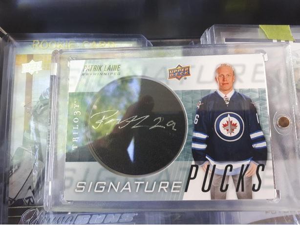 Laine Signature Pucks