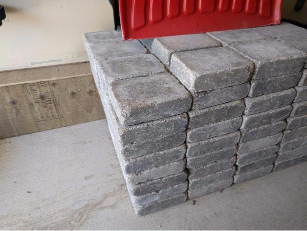 Selling 140 gray tumbled stone bricks