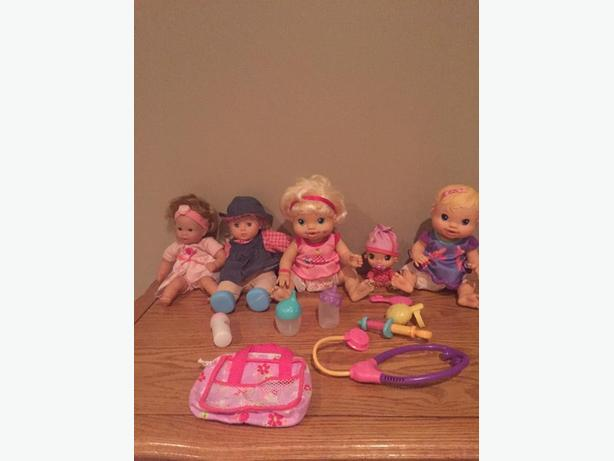 Baby Alive dolls.  Five dolls in total.