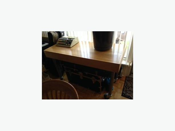 Wood table with adjustable metal legs on casters