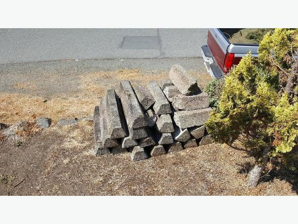 "FREE: 31"" concrete parking blocks"