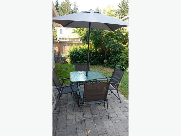 Good condition, four chairs, table and umbrella