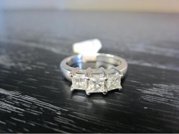 Ladies 14K white gold ring with 3 X 0.25ct princess cut diamond