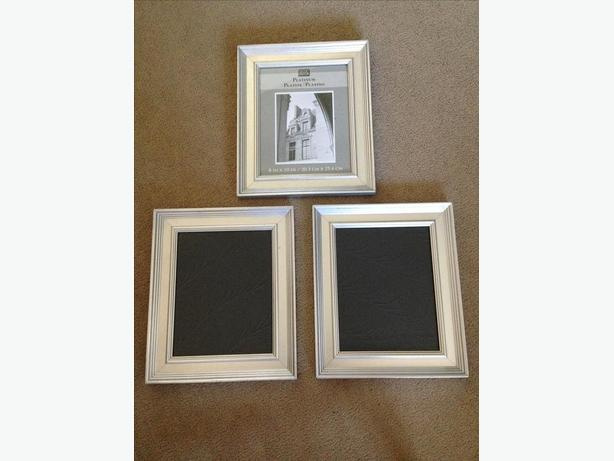 Three StudioDecor 8x10 silver wood picture frames