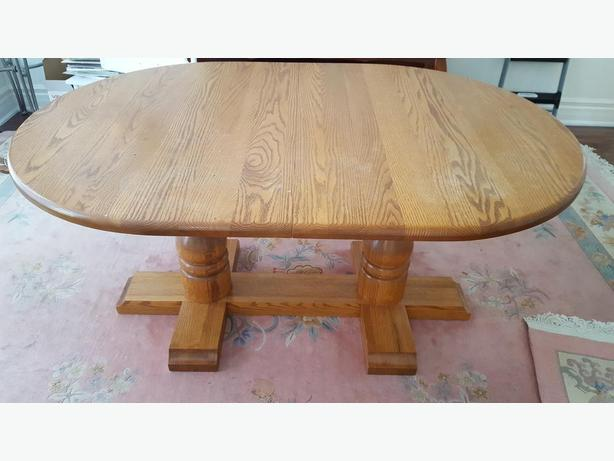 Solid oak dining table with chairs
