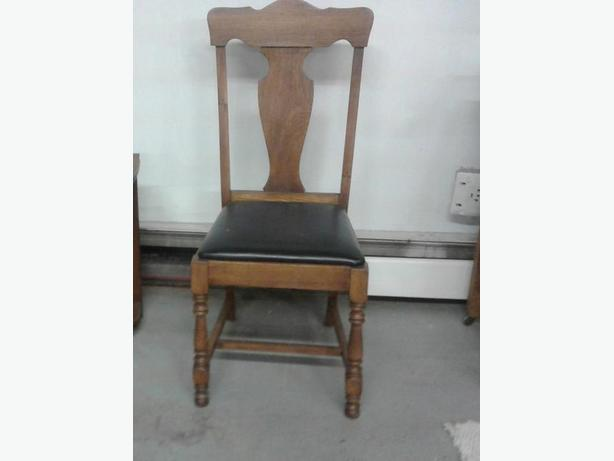 Side chair with padded seat.