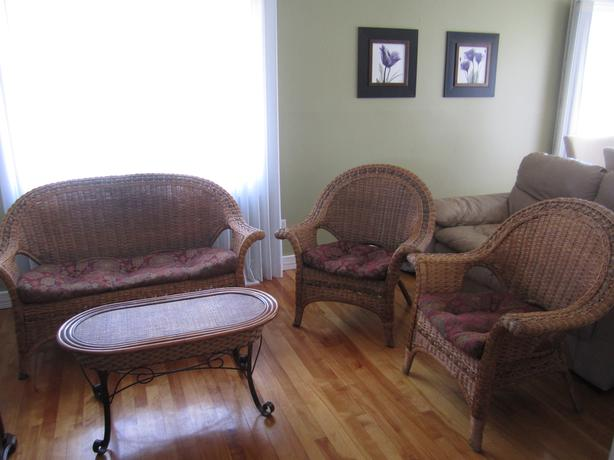 Wicker Furniture - 2 Chairs and a Loveseat ( with cushines ) and Coffee Table