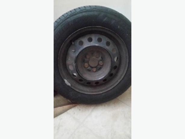 set of 4 almost new tires on rims